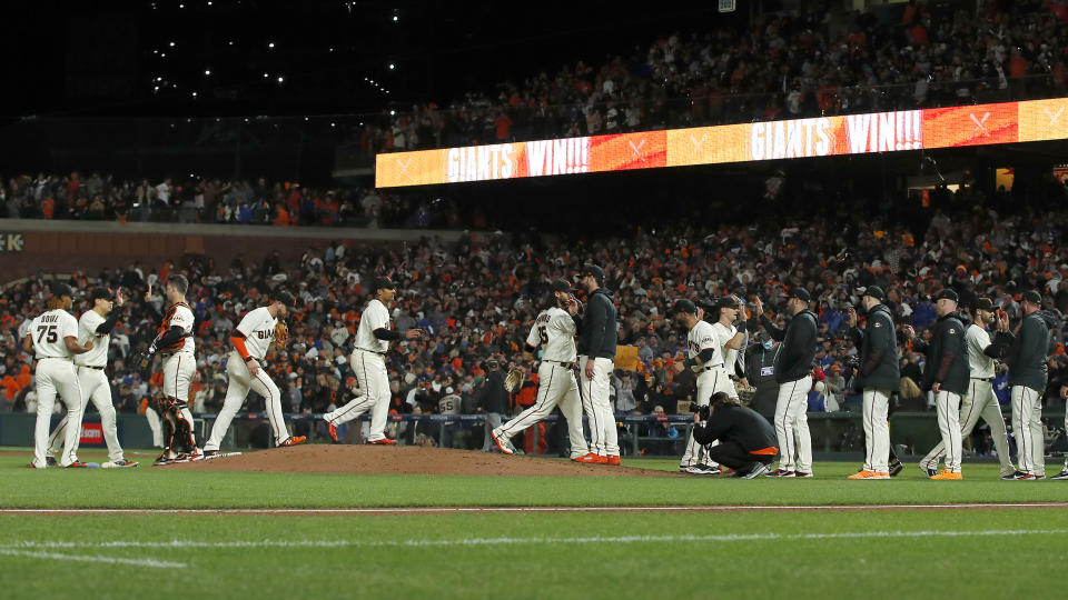 San Francisco Giants players celebrate after defeating the Los Angeles Dodgers in Game 1 of a baseball National League Division Series Friday, Oct. 8, 2021, in San Francisco. (AP Photo/John Hefti)