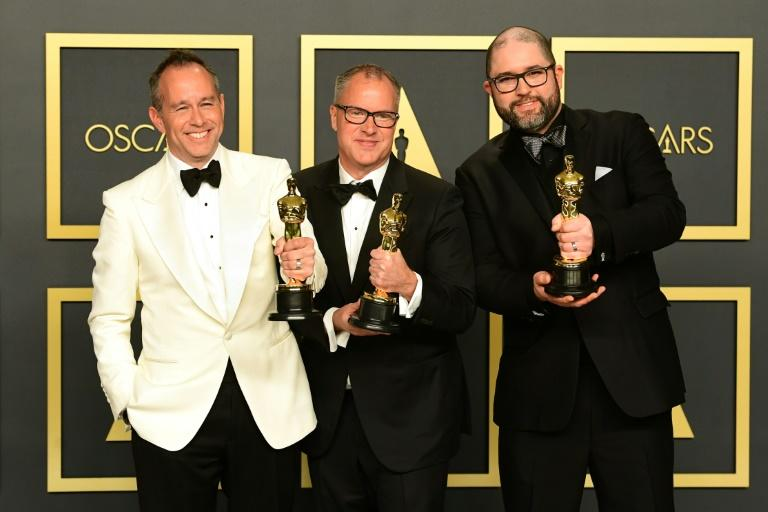 "US producers Jonas Rivera, Mark Nielsen and producer-director Josh Cooley pose with their Oscars for best animated film for ""Toy Story 4"""