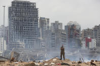 A soldier stands at the devastated site of the explosion in the port of Beirut, Lebanon, Thursday, Aug. 6, 2020. French President Emmanuel Macron came in Beirut to offer French support to Lebanon after the deadly port blast. (AP Photo/Thibault Camus, Pool)