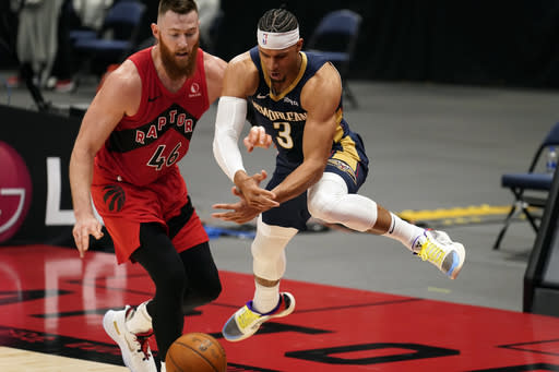 New Orleans Pelicans guard Josh Hart (3) loses the ball in front of Toronto Raptors center Aron Baynes (46) during the second half of an NBA basketball game Wednesday, Dec. 23, 2020, in Tampa, Fla. (AP Photo/Chris O'Meara)