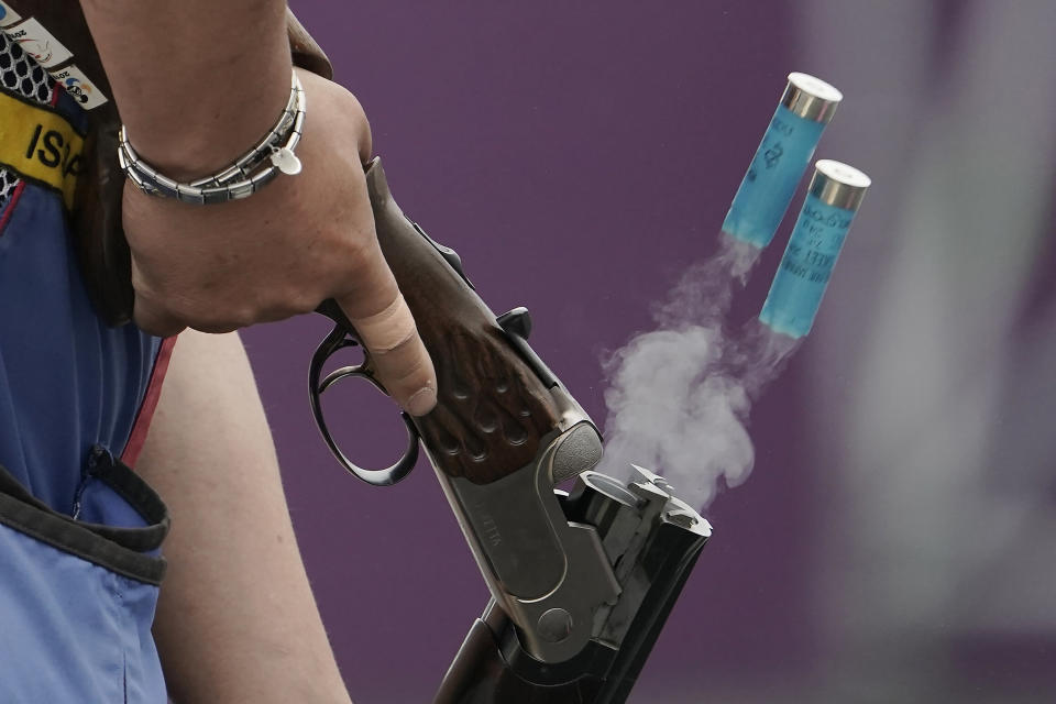 A local athlete ejects spent cartridge shells as he competes in the skeet shooting competition of the Tokyo 2020 Olympic Games shooting test event Tuesday, May 18, 2021, at Asaka Shooting Range in Tokyo. (AP Photo/Eugene Hoshiko)