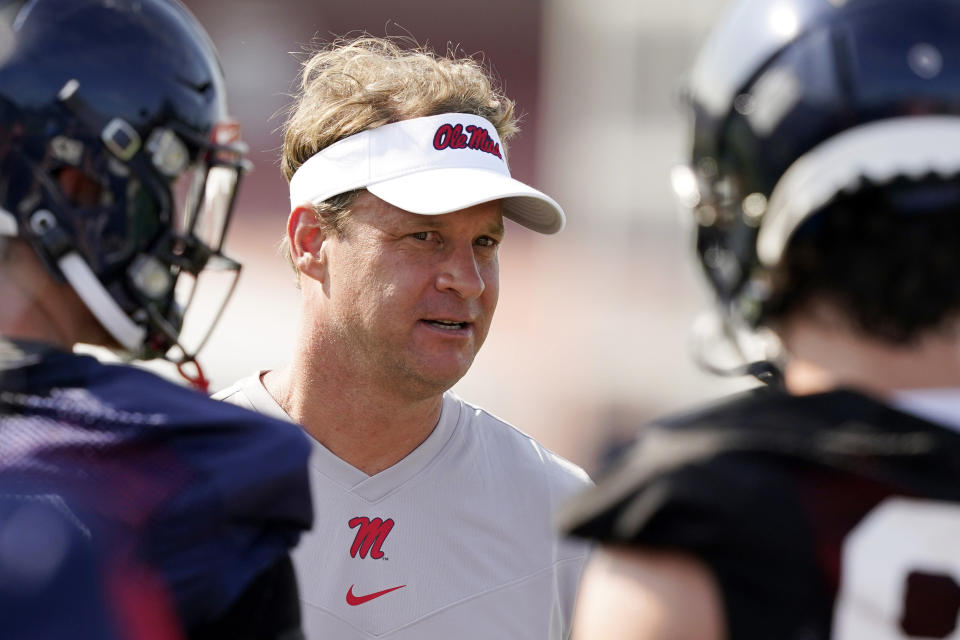 Mississippi coach Lane Kiffin will miss Monday's game against Louisville. (AP Photo/Rogelio V. Solis, File)