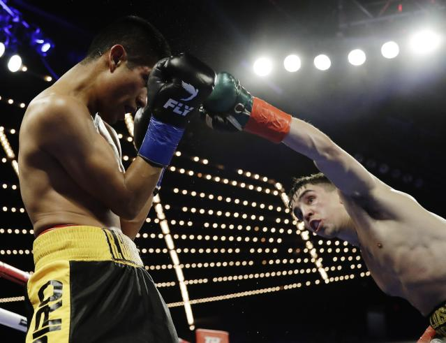 Ireland's Michael Conlan, right, punches Mexico's Ruben Garcia Hernandez during the fourth round of a featherweight boxing match Sunday, March 17, 2019, in New York. Conlan won the fight. (AP Photo/Frank Franklin II)