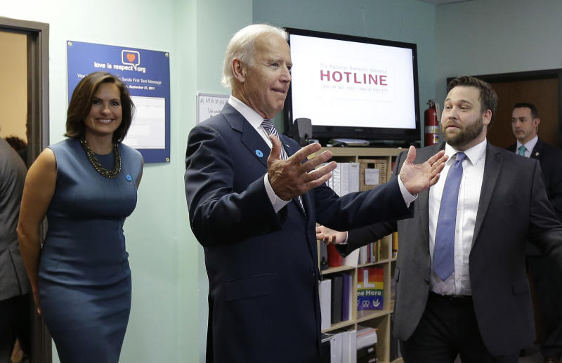 Vice President Joe Biden, center, and actress Mariska Hargitay, left, visit the headquarters of the National Domestic Violence Hotline to help commemorate National Domestic Violence Awareness Month, Wednesday, Oct. 30, 2013, in West Lake Hills. (AP Photo/Eric Gay)