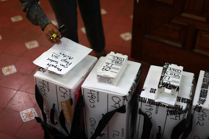 Ballot boxes arrive at an electoral institute district council to be computed in Mexico City, Wednesday July 4, 2012. The computation is done to determine which ballot boxes used in last Sunday's general elections will be recounted in front of party representatives. (AP Photo/Dario Lopez-Mills)