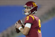 Southern California quarterback Kedon Slovis (9) looks for a receiver during the first quarter of an NCAA college football game against UCLA, Saturday, Dec 12, 2020, in Pasadena, Calif. (AP Photo/Ashley Landis)