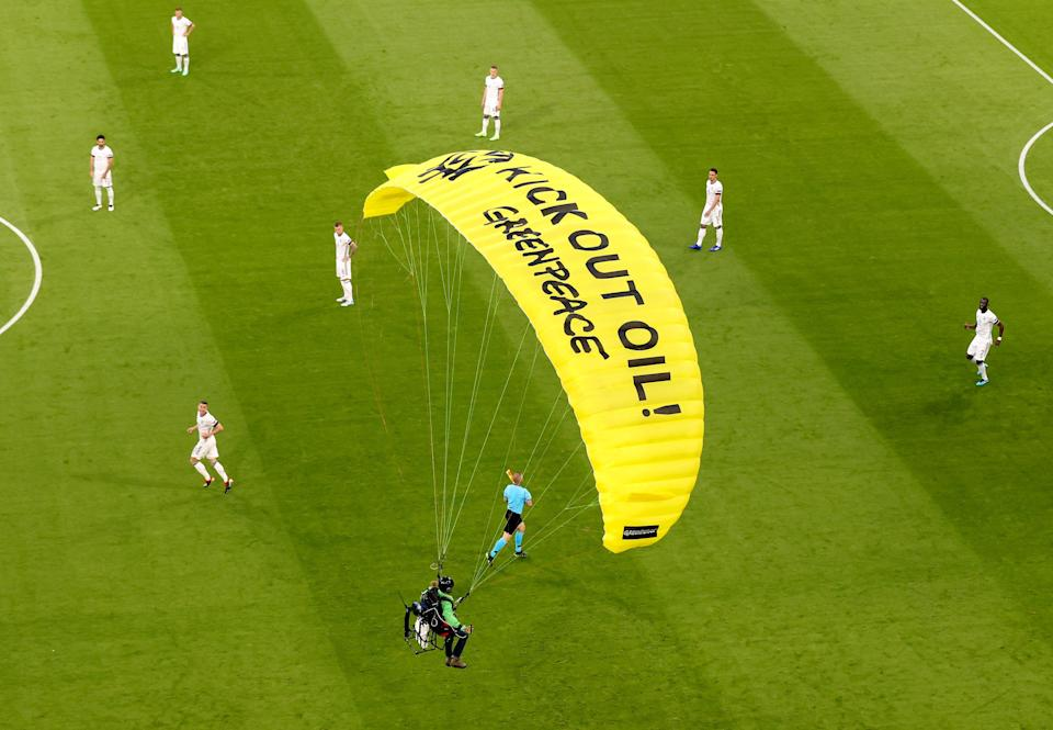 """The activist from Greenpeace had the words """"Kick out oil Greenpeace"""" written on his parachute (AP)"""