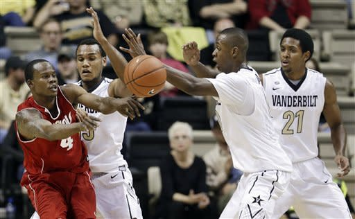 Nicholls State guard Jeremy Smith (4) passes away from Vanderbilt defenders Kevin Bright, second from left, Rod Odom, second from right, and Sheldon Jeter (21) in the first half of an NCAA college basketball game on Saturday, Nov. 10, 2012, in Nashville, Tenn. (AP Photo/Mark Humphrey)