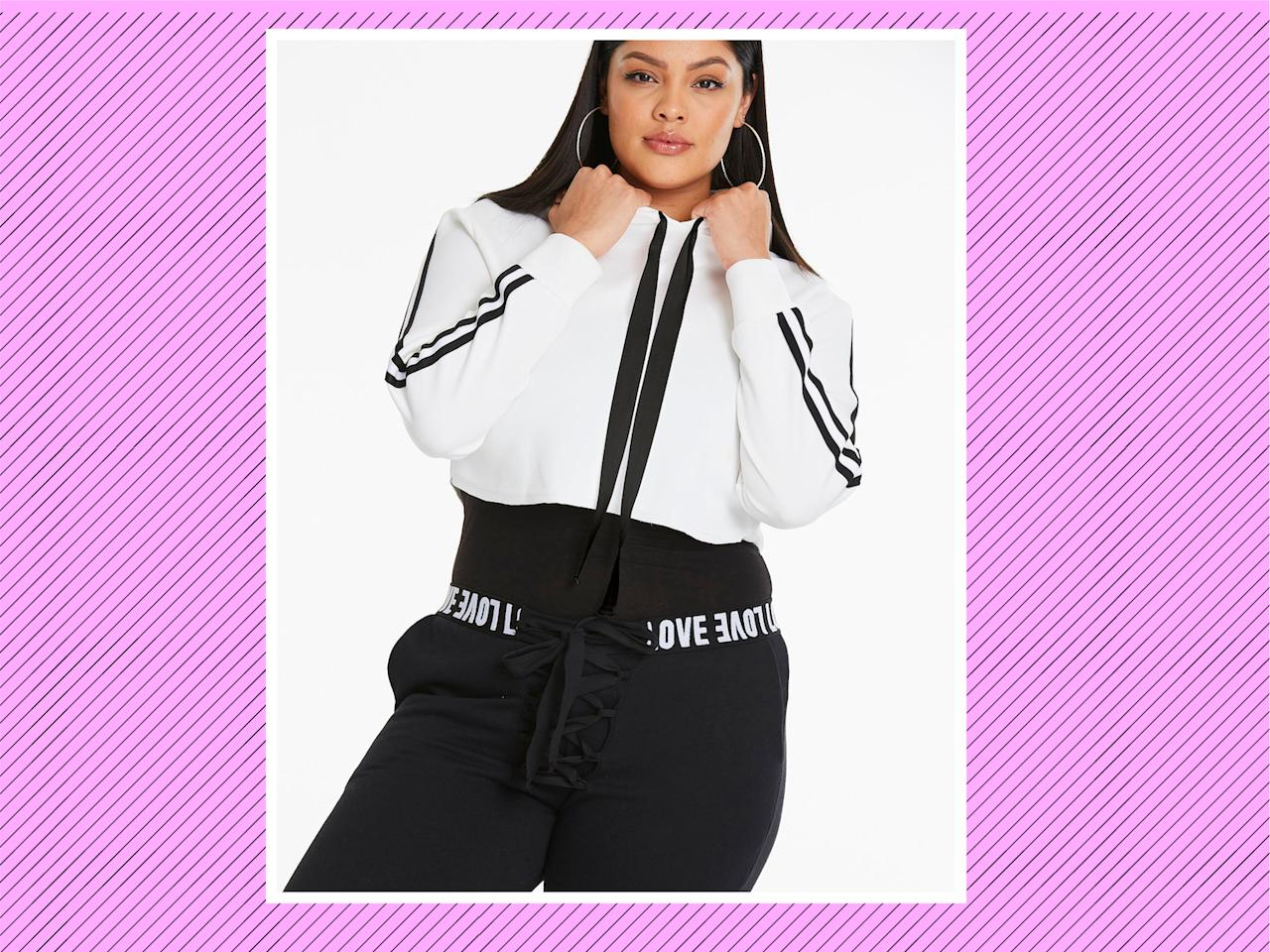 """<p><a rel=""""nofollow"""" href=""""https://www.simplybe.com/en-us/products/crop-hoodie-with-sports-trim/p/WZ618#v=color%3AWZ618_WHITE%7C"""">Crop Hoodie With Sports Trim</a>, $40, and <a rel=""""nofollow"""" href=""""https://www.simplybe.com/en-us/products/lace-up-front-jogger/p/WZ610"""">Lace Up Front Jogger</a>, $46, Simply Be (Photo: Simply Be) </p>"""