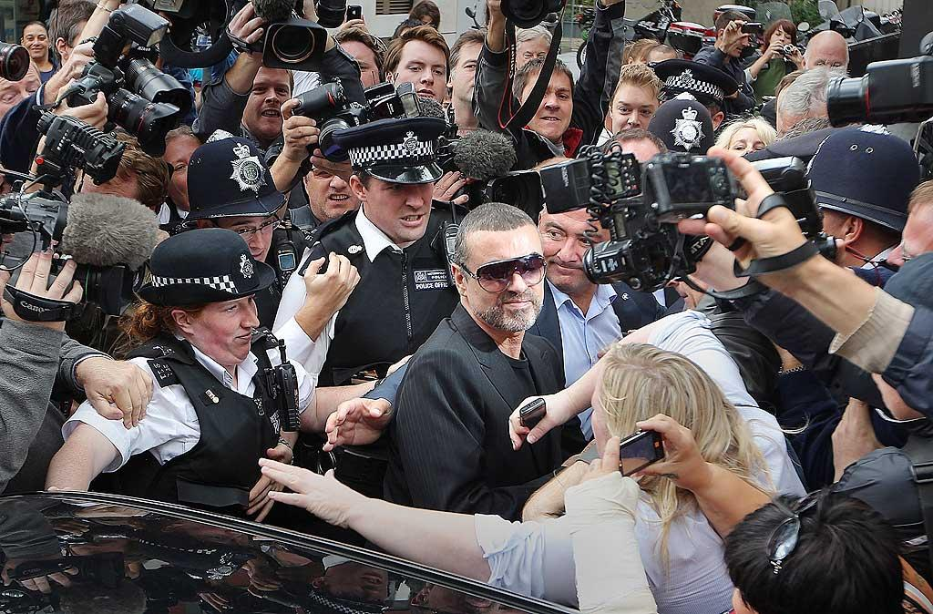 "George Michael left a Magistrates Court in London Tuesday surrounded by a veritable scrum of press and police. The singer pleaded guilty to driving under the influence of drugs after he crashed his car into a photo processing shop in London on July 4, 2010. Peter Macdiarmid/<a href=""http://www.gettyimages.com/"" target=""new"">GettyImages.com</a> - August 24, 2010"