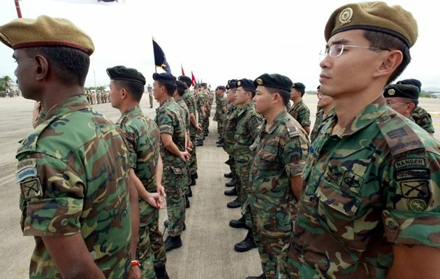PAP MP Hri Kumar has proposed a National Defence Duty tax for PRs and foreigners, with proceeds going to a trsut fund for NS men. (Yahoo! photo)
