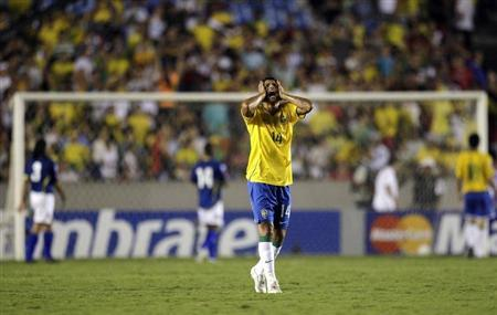 Brazil's Thiago Silva reacts during their 2010 World Cup qualifying soccer match against Colombia in Rio de Janeiro