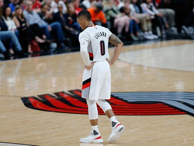 """<a class=""""link rapid-noclick-resp"""" href=""""/nba/players/5012/"""" data-ylk=""""slk:Damian Lillard"""">Damian Lillard</a> searches for space. (Getty Images)"""