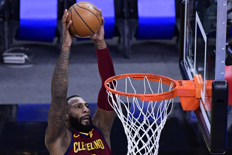 ORLANDO, FLORIDA - JANUARY 06: Andre Drummond #3 of the Cleveland Cavaliers slams the ball during the second quarter against the Orlando Magic at Amway Center on January 06, 2021 in Orlando, Florida. NOTE TO USER: User expressly acknowledges and agrees that, by downloading and or using this photograph, User is consenting to the terms and conditions of the Getty Images License Agreement. (Photo by Douglas P. DeFelice/Getty Images)
