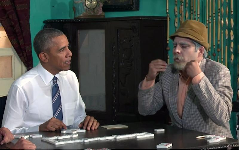 TV grab released by Cubadebate shows US President Barack Obama (L) playing dominoes with Cuban TV character Don Panfilo during a Cuban TV show in Havana (AFP Photo/HO)