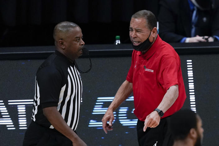 Houston head coach Kelvin Sampson questions a call during the second half of a men's Final Four NCAA college basketball tournament semifinal game against Baylor, Saturday, April 3, 2021, at Lucas Oil Stadium in Indianapolis. (AP Photo/Michael Conroy)
