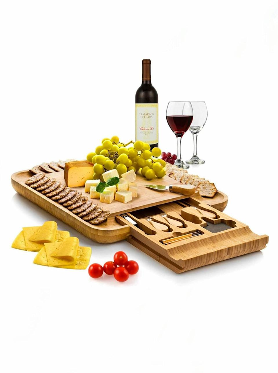 "It it even possible to go wrong when a cheese board is involved? Didn't think so. Gift her this dinner party essential and all of her favorite finger foods, then craft a photo-worthy charcuterie spread together. $50, Amazon. <a href=""https://www.amazon.com/dp/B01DTFF0Y8/"" rel=""nofollow noopener"" target=""_blank"" data-ylk=""slk:Get it now!"" class=""link rapid-noclick-resp"">Get it now!</a>"