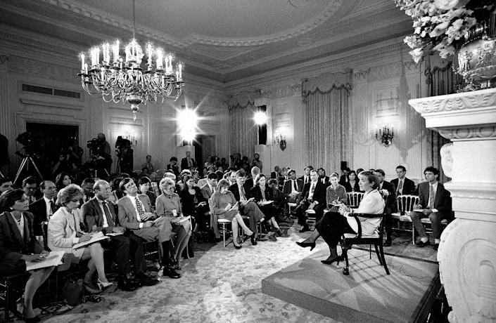 Addressing the press and taking questions on a wide range of topics in the East Room of the White House. The seventy-two-minute Q&A came months after reporters began demanding that Clinton discuss her role in criticized commodity trades and an Arkansas land deal first reported on in 1992. It was her only such event during her tenure as First Lady. April 22, 1994.