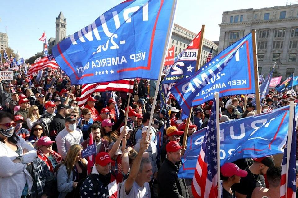 "People participate in the ""Million MAGA March"" from Freedom Plaza to the Supreme Court, on November 14, 2020 in Washington, DC. Supporters of U.S. President Donald Trump marching to protest the outcome of the 2020 presidential election. (Photo by Tasos Katopodis/Getty Images)"