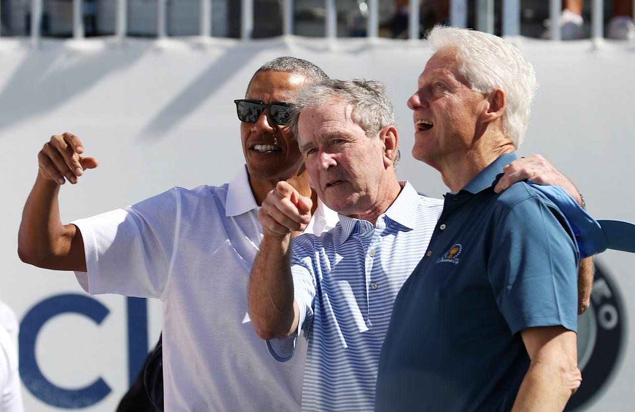 <p>(L-R) Former U.S. President Barack Obama, Former U.S. President George W. Bush and former U.S. President Bill Clinton attend the trophy presentation prior to Thursday foursome matches of the Presidents Cup at Liberty National Golf Club on September 28, 2017 in Jersey City, New Jersey. (Photo by Rob Carr/Getty Images) </p>