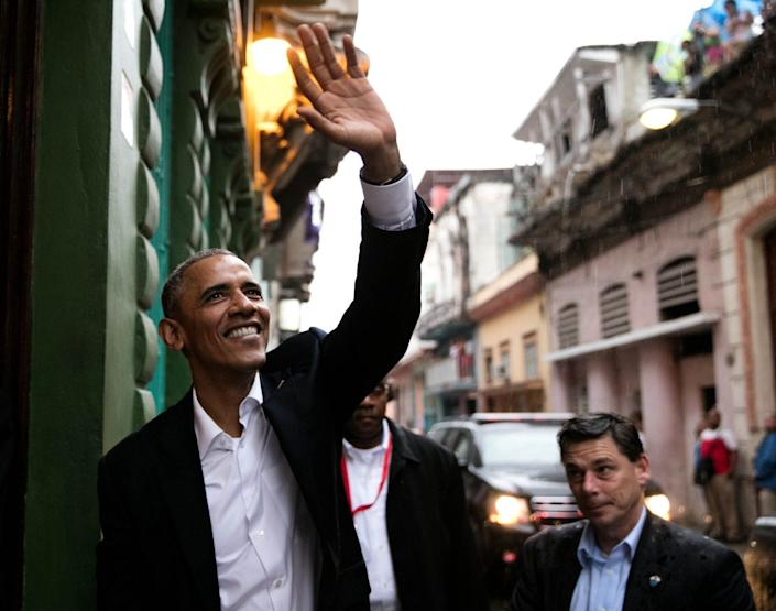 Obama waves to people as he enters a restaurant in Havana.