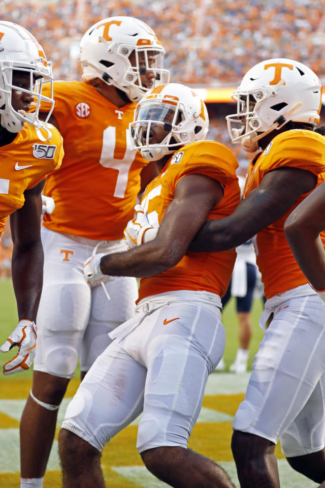 Tennessee wide receiver Jauan Jennings (15) celebrates scoring a touchdown with teammates in the first half of an NCAA college football game against Brigham Young Saturday, Sept. 7, 2019, in Knoxville, Tenn. (AP Photo/Wade Payne)