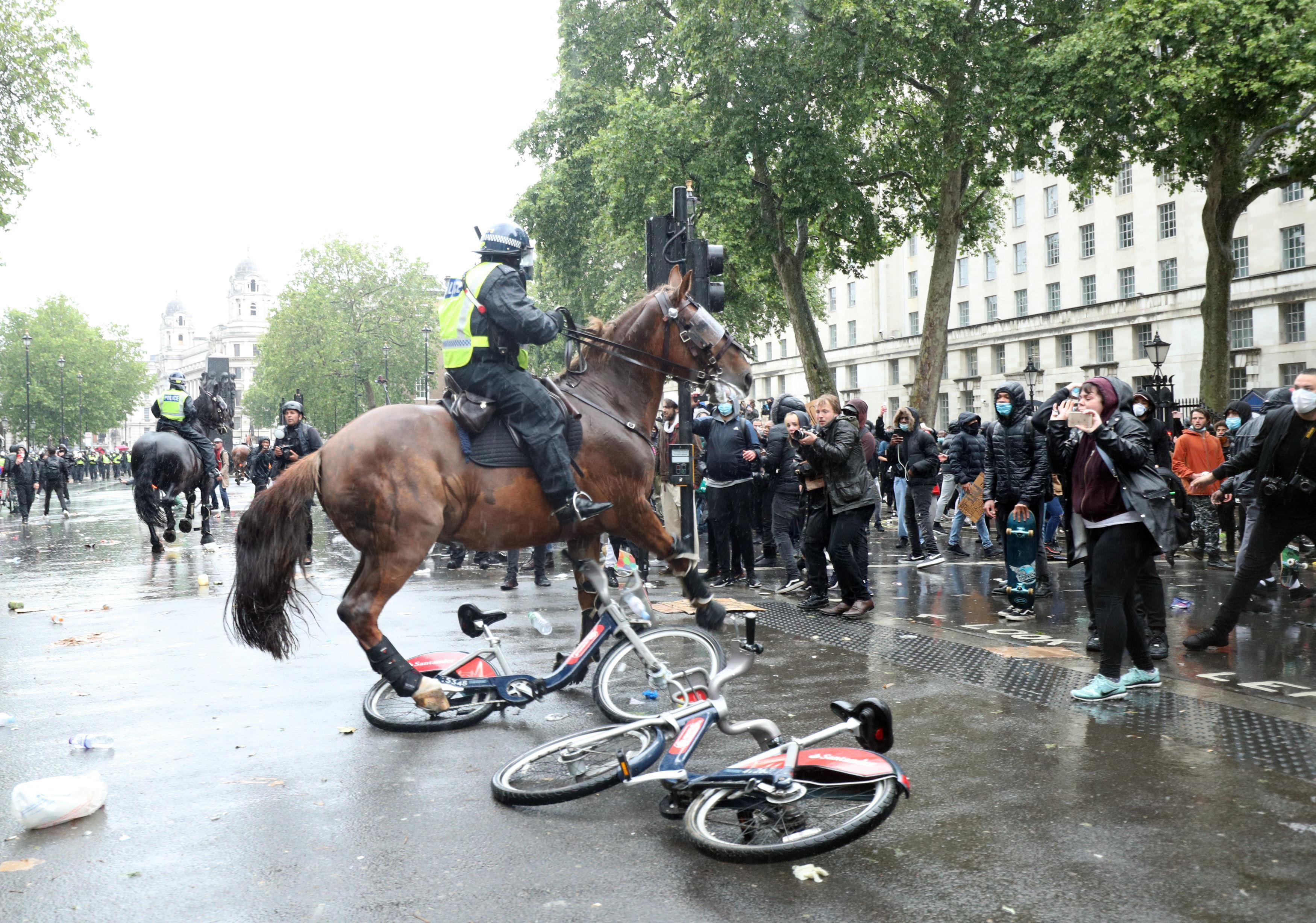 Police on horseback in Whitehall following a Black Lives Matter protest rally in Parliament Square, London, in memory of George Floyd who was killed on May 25 while in police custody in the US city of Minneapolis. PA Photo. Picture date: Saturday June 6, 2020. See PA story POLICE Floyd. Photo credit should read: Yui Mok/PA Wire