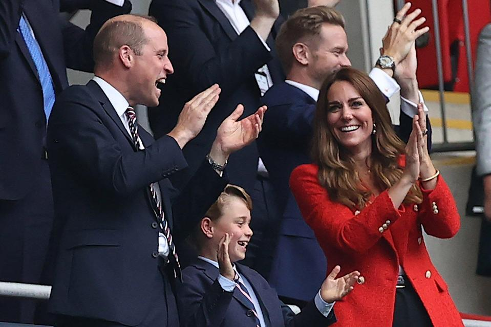 The British Prince William, Duke of Cambridge, his wife Kate, Duchess of Cambridge, and their son Prince George celebrate the 1:0.
