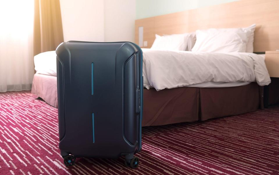 This wheelie suitcase will shortly wake every guest on the first floor - Getty