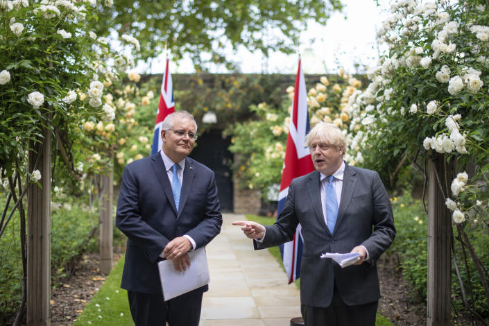 Britain's Prime Minister Boris Johnson, right, speaks with Australian Prime Minister Scott Morrison after their meeting, in the garden of 10 Downing Streeet, in London, Tuesday June 15, 2021. Britain and Australia have agreed on a free trade deal that will be released later Tuesday, Australian Trade Minister Dan Tehan said. (Dominic Lipinski/Pool Photo via AP)