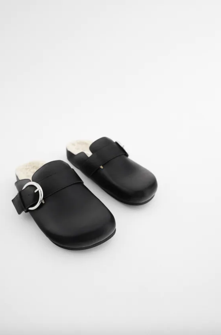 "<br><br><strong>Zara</strong> FAUX FUR LINED BUCKLE CLOGS TRF, $, available at <a href=""https://go.skimresources.com/?id=30283X879131&url=https%3A%2F%2Fwww.zara.com%2Fus%2Fen%2Ffaux-fur-lined-buckle-clogs-trf-p13538610.html%3Fv1%3D57840994"" rel=""nofollow noopener"" target=""_blank"" data-ylk=""slk:Zara"" class=""link rapid-noclick-resp"">Zara</a>"