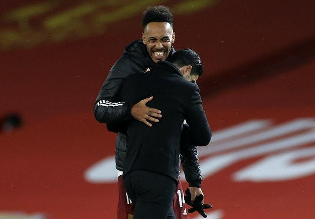 Mikel Arteta, left, and Pierre-Emerick Aubameyang celebrate the win over Manchester United