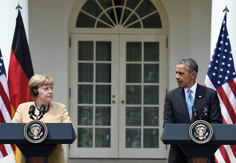 US President Barack Obama (R) and German Chancellor Angela Merkel during a press conference at the Rose Garden of the White House on May 2, 2014 in Washington, DC (AFP Photo/Jewel Samad)