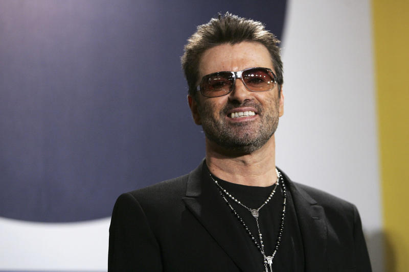 """Singer George Michael poses at the """"George Michael: A Different Story"""" Photocall during the 55th annual Berlinale International Film Festival on February 16, 2005 in Berlin, Germany."""