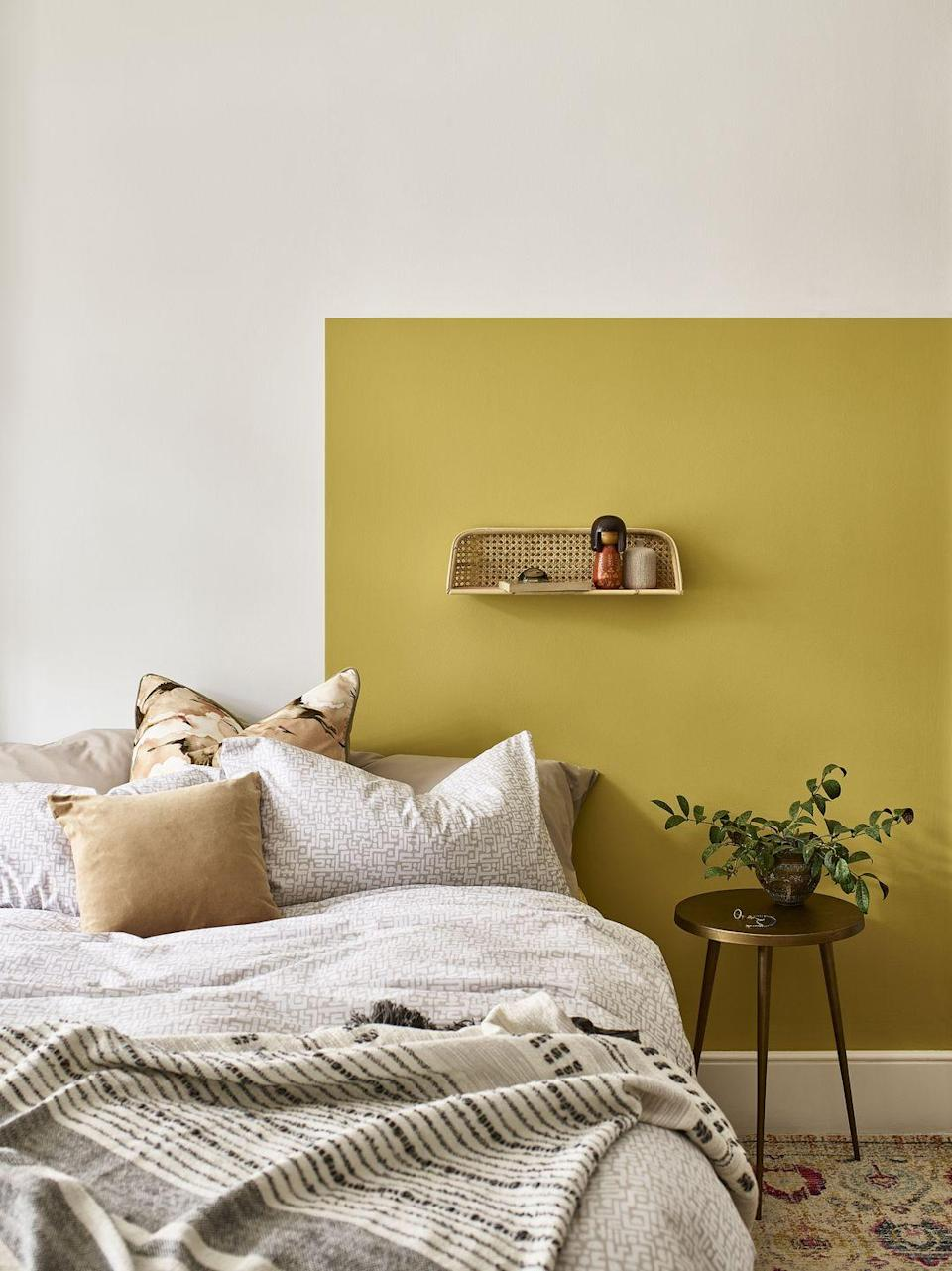 """<p>Most commonly, a feature wall is used to create more of a focal point and will make the perfect backdrop to a bed.</p><p>The experts at Dulux explain: 'If you have architectural elements on an alternative wall, such as a fireplace or the entrance to an en-suite or <a href=""""https://www.housebeautiful.com/uk/decorate/bedroom/a30966899/walk-in-wardrobe-ideas/"""" rel=""""nofollow noopener"""" target=""""_blank"""" data-ylk=""""slk:walk-in wardrobe"""" class=""""link rapid-noclick-resp"""">walk-in wardrobe</a>, this could lend itself perfectly to becoming the accent wall. Feature walls can be used to add depth and the illusion of space to smaller rooms, so experiment with painting an accent wall at the far end or on the side of the bed to maximise your room's potential.'</p>"""