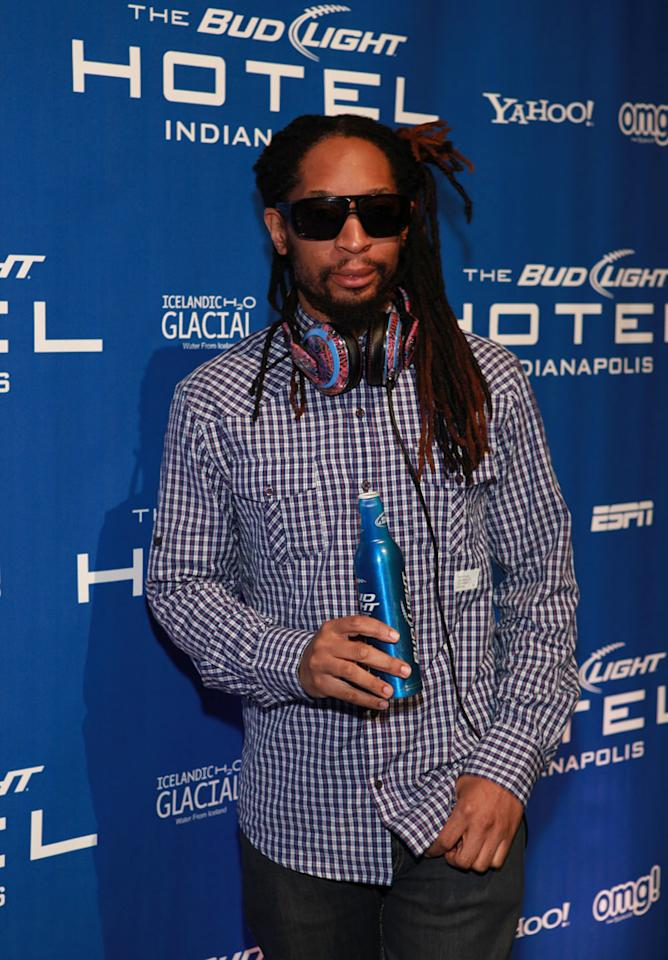 """Lil Jon was the first celeb to roll down the blue carpet at the Bud Light Hotel in Indianapolis for Saturday night's concert featuring performances by Pit Bull and 50 Cent. The rapper -- who sported a plaid shirt, sunglasses, and headphones along with his flashy grill -- was pumped about his gig as the night's DJ. """"I am associated with partying!"""" he laughed."""