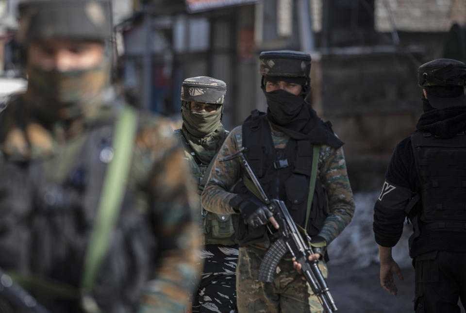 Indian paramilitary soldiers arrive near the site of a shootout in Srinagar, Indian controlled Kashmir, Friday, Feb. 19, 2021. Anti-India rebels in Indian-controlled Kashmir killed two police officers in an attack Friday in the disputed region's main city, officials said. Elsewhere in the Himalayan region, three suspected rebels and a policeman were killed in two gunbattles. (AP Photo/Mukhtar Khan)