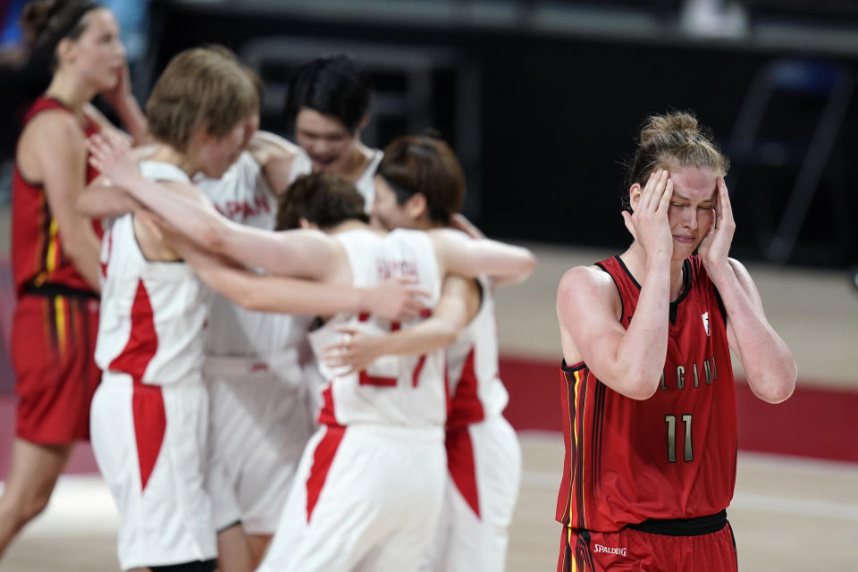 Belgium's Emma Meesseman (11) walks off the court at the end of a women's basketball quarterfinal round game against Japan at the 2020 Summer Olympics, Wednesday, Aug. 4, 2021, in Saitama, Japan. (AP Photo/Charlie Neibergall)
