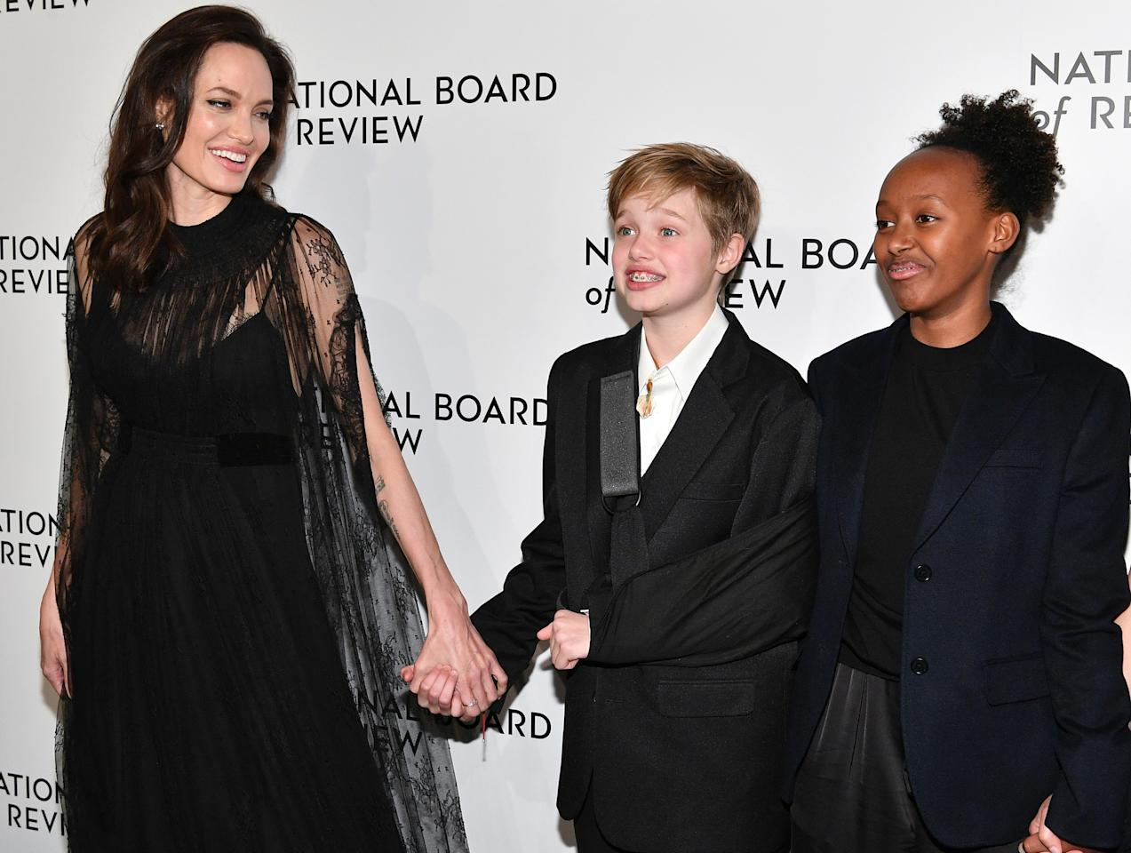 "<p>Angelina also brought Shiloh and Zahara to the National Board of Review Awards Gala on Jan. 9, where she accepted the Freedom of Expression Award for her film <em>First They Killed My Father. </em>Shiloh sported a sling after her <a rel=""nofollow"" href=""https://www.yahoo.com/lifestyle/angelina-jolie-apos-daughter-shiloh-134711903.html"">recent snowboarding accident</a>. (Photo: Dia Dipasupil/FilmMagic) </p>"