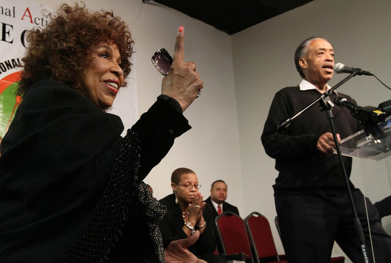 """Singer Roberta Flack, left, gestures as Rev. Al Sharpton, right, speaks during a tribute to """"Soul Train"""" creator Don Cornelius at Sharpton's National Action Network in New York Saturday, Feb. . 4, 2012. Cornelius died this week at his Los Angeles home of a self-inflicted gunshot wound. He was 75. (AP Photo/Tina Fineberg)"""