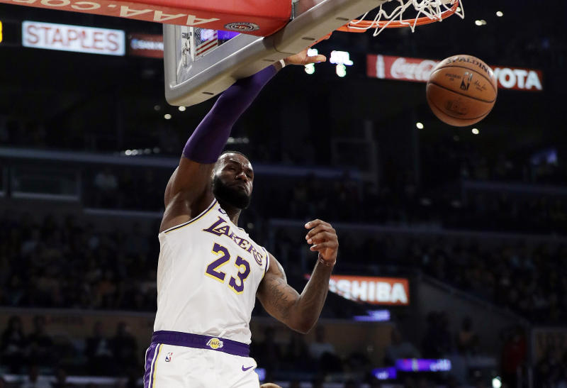 A late put-back dunk from LeBron James and a critical block by Tyson  Chandler sent the Lakers past the Hawks on Sunday night in Los Angeles. 290370ab5