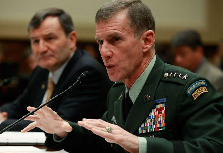 U.S. Army Gen. Stanley McChrystal (R), commander of the International Security Assistance Force and commander of United States Forces Afghanistan and Karl Eikenberry (L), U.S. Ambassador to Afghanistan, participate in a House Foreign Affairs Committee hearing on Capitol Hill, on December 10, 2009 in Washington, D.C.