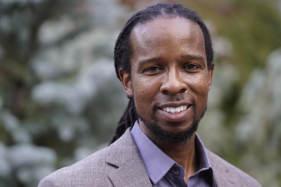 """FILE - In this Oct. 21, 2021, file photo, Ibram X. Kendi, director of Boston University's Center for Antiracist Research, stands for a portrait in Boston. Racism, COVID-19 and other big issues of the day figure prominently in the work of many of the 25 recipients of this year's John D. and Catherine T. MacArthur Foundation's """"genius grants,"""" announced Tuesday, Sept. 28, 2021. The group includes Ibram X. Kendi, the best selling author of """"How to be an Antiracist."""" (AP Photo/Steven Senne, File)"""