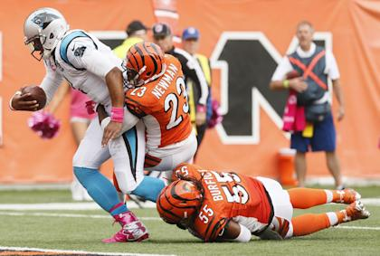 Vontaze Burfict (55) has the leg of Cam Newton as the Panthers QB finishes a 12-yard touchdown run. (AP)