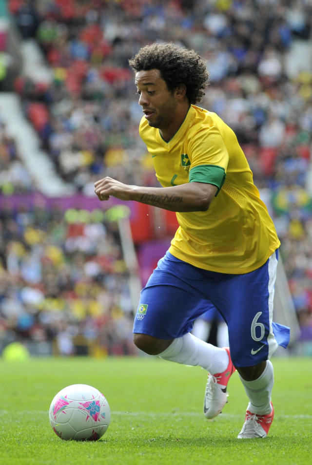 MANCHESTER, UNITED KINGDOM - JULY 29: Marcelo of Brazil battle for the ball during the Men's Football first round Group C Match between Brazil and Belarus on Day 2 of the London 2012 Olympic Games at Old Trafford on July 29, 2012 in Manchester, England. (Photo by Francis Bompard/Getty Images)