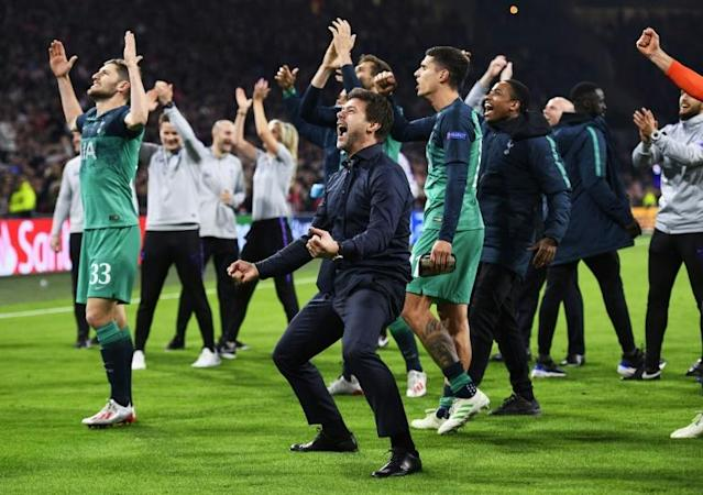 Time to go again: Tottenham players manager Mauricio Pochettino (centre) celebrated a famous Champions League semi-final win at Ajax in May (AFP Photo/Olaf Kraak)