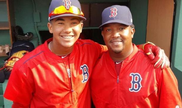Hall of Famer Pedro Martinez (left) and his son, Pedro Martinez Jr., pose at Fenway Park. (AP)