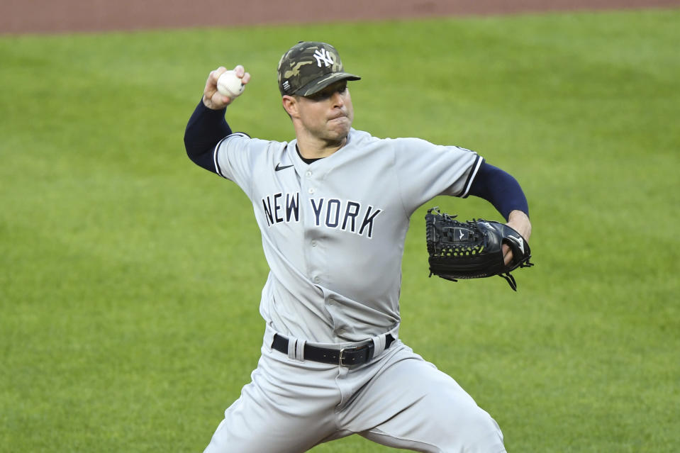 New York Yankees starting pitcher Corey Kluber throws during the first inning of a baseball game against the Baltimore Orioles on Friday, May 14, 2021, in Baltimore. (AP Photo/Terrance Williams)