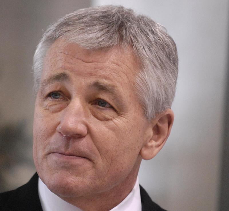 FILE - This Dec, 18, 2008 file photo shows then-Nebraska Sen. Chuck Hagel in Omaha, Neb. Senior administration officials tell The Associated Press that President Barack Obama could name his next defense secretary in December, far sooner than expected and perhaps in a high-powered package announcement along with his choice for secretary of state. The top names under consideration for defense secretary are former Republican Sen. Chuck Hagel of Nebraska, deputy defense secretary Ashton Carter, former top Pentagon official Michele Flournoy, and Sen. John Kerry, D-Mass.  (AP Photo/Dave Weaver, File)