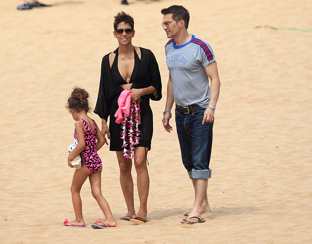Halle Barry, her daughter Nahla, and partner Olivier Martinez were spotted on a spring break vacation in Hawaii. Nayla played in the sand while mom Halle looked on smiling. Pictured: Halle Berry, Nahla Aubry and Olivia Martinez Ref: SPL517297 270313 Picture by: starsurf/Stewy/Splash News Splash News and Pictures Los Angeles:310-821-2666 New York:212-619-2666 London:870-934-2666 photodesk@splashnews.com